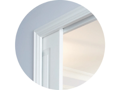A close-up of the architrave around a classic style pocket door system.